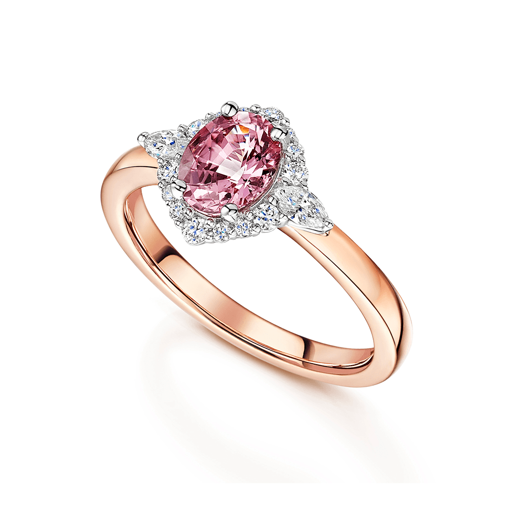 18ct Rose Gold Oval Cut Unheated Padparadscha Sapphire Ring With A Diamond Halo Surround